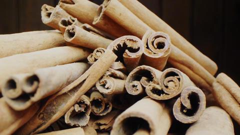 aromatic cinnamon sticks on dark blurred background macro Live Action