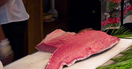 Chef hands cutting raw bluefin tuna to filet pieces 4k video. Japanese cuisine Footage