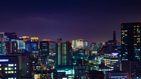 A night timelapse of cityscape at the urban city in Tokyo medium shot zoom Live Action