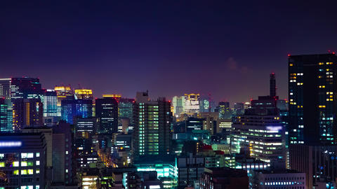 A night timelapse of cityscape at the urban city in Tokyo medium shot Live Action
