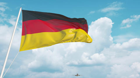 Airliner approaches the German national flag. Tourism in Germany Live Action