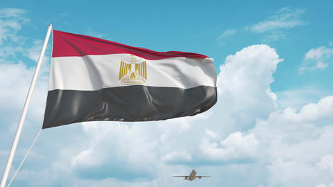Airliner approaches the Egyptian national flag. Tourism in Egypt Live Action