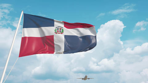 Commercial airplane landing behind the Dominican national flag. Tourism in Live Action