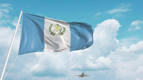 Plane arrives to airport with national flag of Guatemala. Guatemalan tourism Live Action