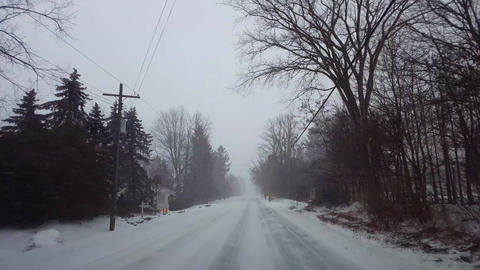 Driving Winter Snow Storm on in Residential Suburb in Day. Driver Point of View POV Snowing Blizzard Live Action