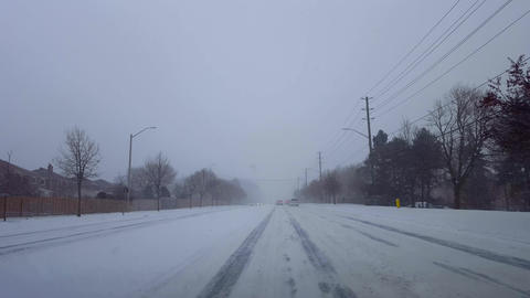 Driving Winter Snow Storm With Vehicle Traffic in Day. Driver Point of View POV Snowing Blizzard Live Action