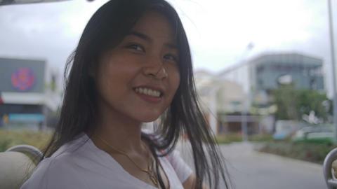 Joyful young Asian Woman in shuttle car Live Action
