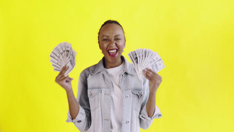 Satisfied happy excited african american woman showing money and saying O MY GOD Live Action