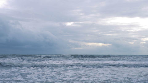 Sea waves with foam in cloudy rainy day Live Action