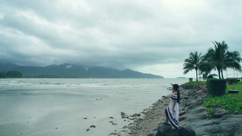 Young Woman looking at the sea Live Action