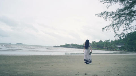 Thai Girl in white dress enjoying of breeze at beach Live Action