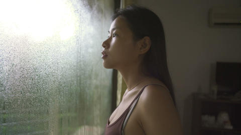 Young Asian Woman opens curtains at morning Live Action
