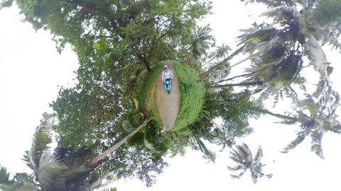 Riding a scooter in jungles of tiny planet Live Action
