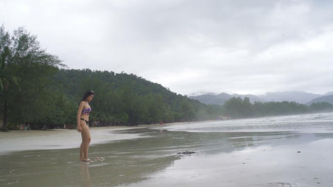 Thai Girl takes off her shoes and runs at tropical beach Live Action
