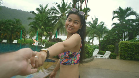 Thai Girl walking to swimming pool and holding her boyfriend's hand Live Action