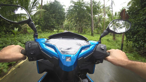 POV video of riding scooter on dirty road on island after tropical storm Live Action
