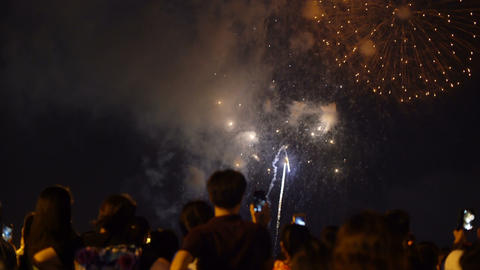 People watching fireworks and recording video with smartphones Live Action
