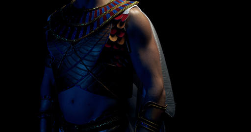 Ancient pharaoh in traditional clothes and headwear in dramatic lighting, 4k Live Action