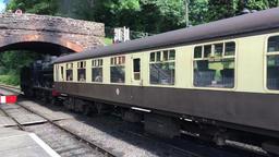 Steam train leaving station on West Somerset Railway Bishops Lydeard UK Footage