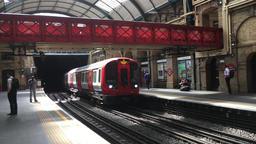London Underground train arriving at Paddington station UK Footage