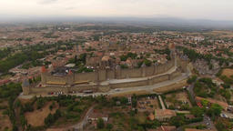 Aerial: low flight over beautiful French fortress Carcassonne at sunset Footage