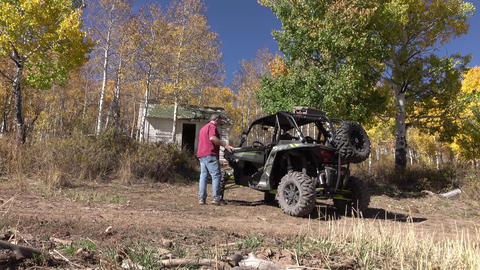 4x4 recreation man walks to RZR autumn forest 4K Live Action