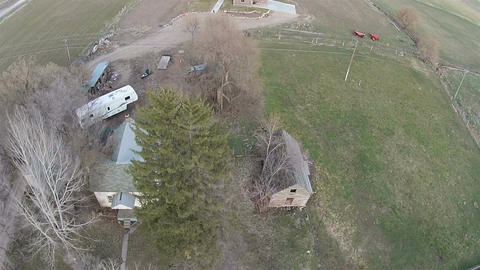 Aerial flight over rural town to modern farm house HD 016 Footage