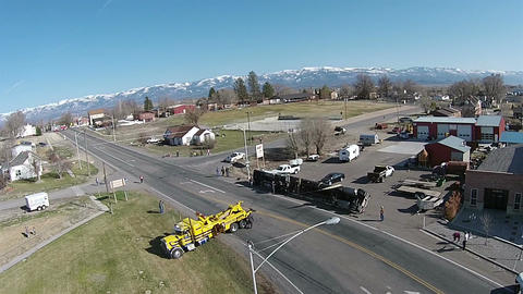 Aerial semi truck and trailer roll over accident rural town HD 0031 Footage
