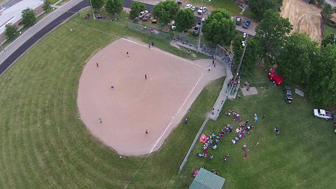 Aerial softball game fly ball out rural town HD 015 GIF