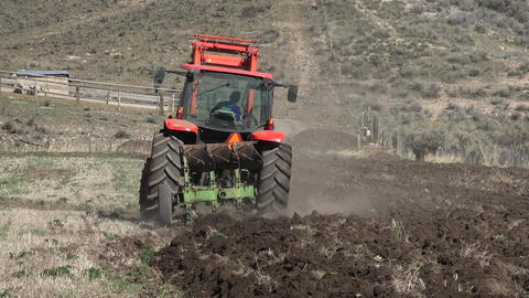 April farmer plowing field for spring planting fast 4K 023 Footage