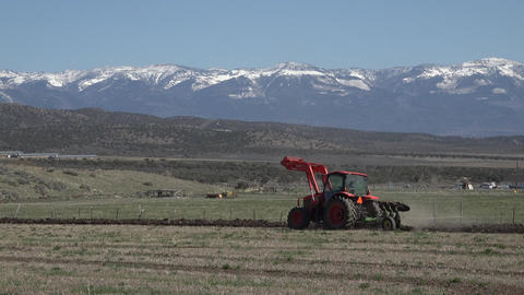 April farmer tractor plow field for spring planting fast 4K 015 Footage