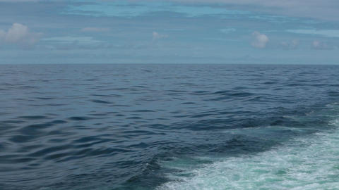 Beautiful blue Pacific Ocean horizon wake behind cruise ship HD 7805 Footage