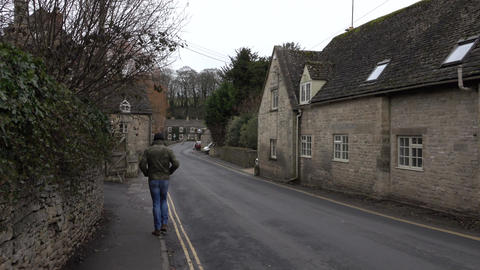 Bibury Cotswold England narrow road stone homes 4K Footage