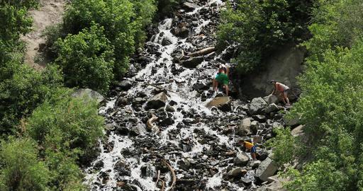 Bridal Veil Falls family climbs waterfall mountain DCI 4K Footage