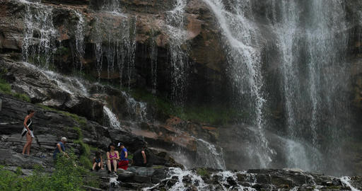 Bridal Veil Falls family under waterfall mist DCI 4K Footage