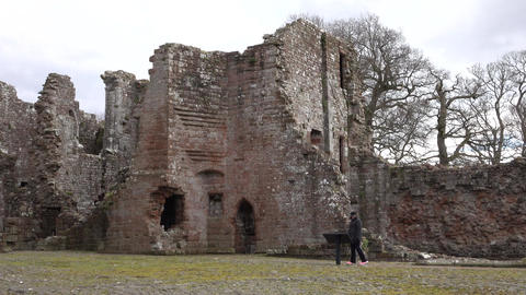 Brougham Castle ruins England woman history tour 4K Footage