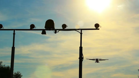 Airliner lands flying above camera, landing light posts, daytime Footage