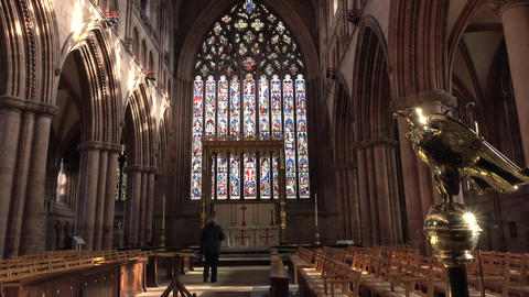 Carlisle Cathedral England woman walks to altar beautiful window 4K Footage