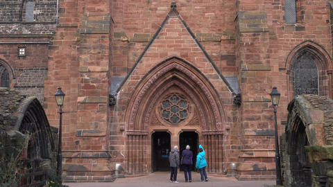 Carlisle Cathedral members at beautiful historic entrance England 4K Footage