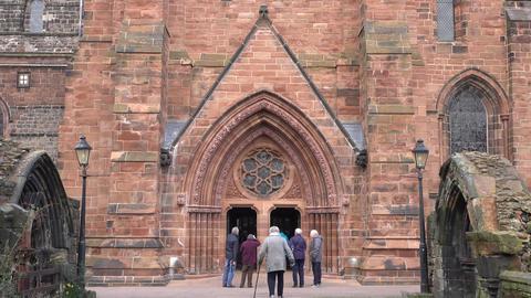 Carlisle England Cathedral senior member entering historic 4K Footage