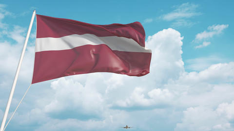 Plane arrives to airport with flag of Latvia. Latvian tourism Live Action