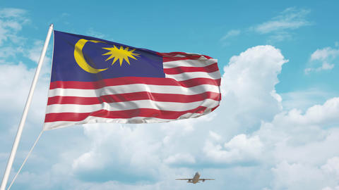 Plane arrives to airport with national flag of Malaysia. Malaysian tourism Live Action