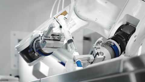 The innovative arms of a robotic arm make an injection of chemotherapy for a Live Action