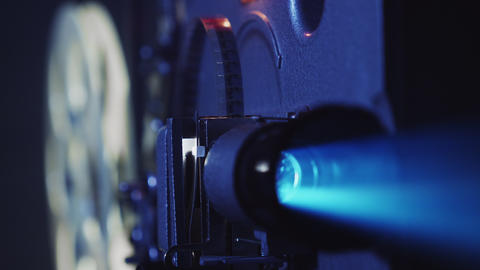 Old film projector shows a film, close-up Live Action