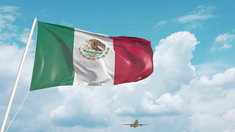 Airliner approaches the Mexican national flag. Tourism in Mexico Live Action