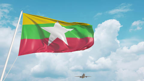 Airliner approaches the Myanma national flag. Tourism in Myanmar Live Action