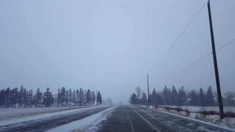 *Brighter Version* Driving Winter Snow Storm on Rural Road in Day. Driver Point of View POV Snowing Live Action
