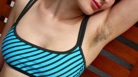 Natural woman with unshaven armpits. Woman's natural hair, feminist concept Live Action