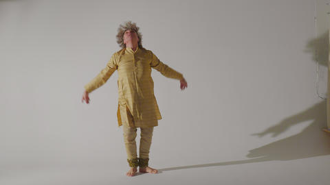 Man dancing Indian dance in traditional dress general outline Live Action