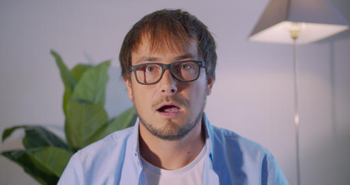 A man in surprise shoots glasses and looks at the camera in surprise Live Action